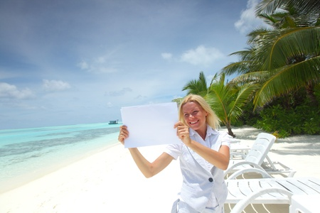 business woman with blank paper on the desolate ocean coast Stock Photo - 10895999