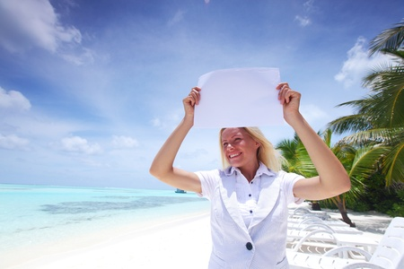 business woman with blank paper on the desolate ocean coast Stock Photo - 10895989