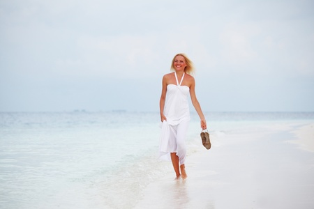 woman in a white dress on the ocean coast Stock Photo - 10895822