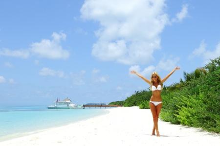 beautiful legs: woman in bikini on sea background