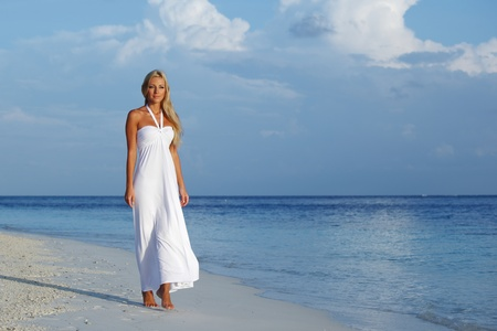woman in a white dress on the ocean coast Stock Photo - 10895850