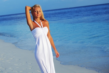 woman in a white dress on the ocean coast Stock Photo - 10896042