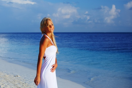 woman in a white dress on the ocean coast Stock Photo - 10896008