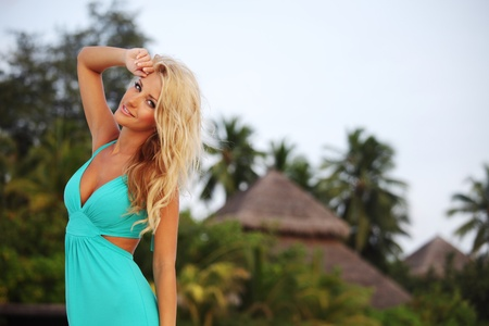 woman in a dress on a background of palm trees Stock Photo - 10895899
