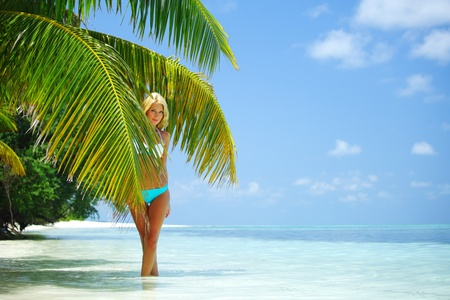 woman in a bikini on a background of palm trees Stock Photo - 10895940