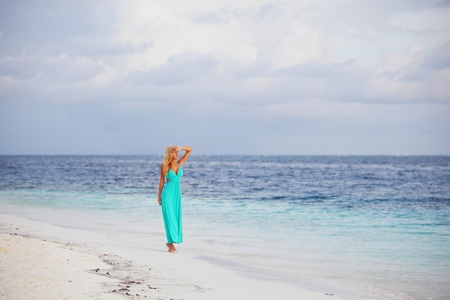 woman in a blue dress on the ocean coast Stock Photo - 10895901