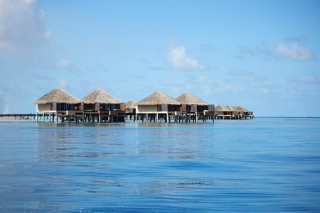 resort maldivian houses in blue sea Stock Photo - 10895956
