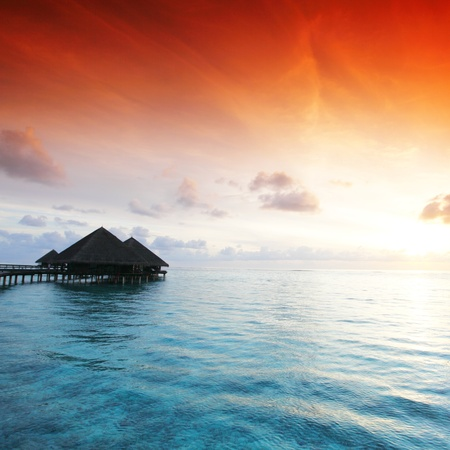 bungalows: resort maldivian houses on sunrise Editorial