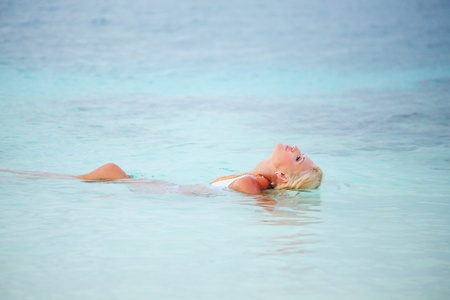 woman  playing in ocean water Stock Photo - 10895931