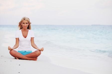 yoga woman on sea coast Stock Photo - 10895818