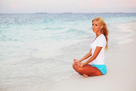 yoga woman on sea coast Stock Photo - 10896014