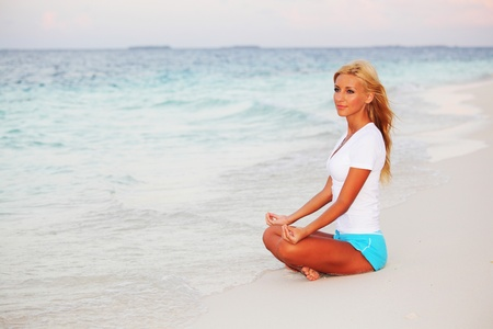 yoga woman on sea coast Stock Photo - 10896014