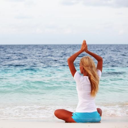 yoga woman on sea coast Stock Photo - 10895862