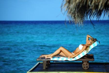 woman on lounge sea on background Stock Photo - 10895985