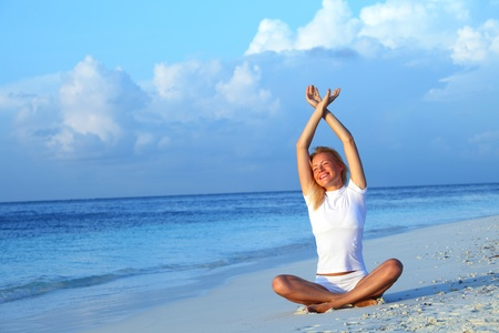 yoga woman on sea coast Stock Photo - 10895997