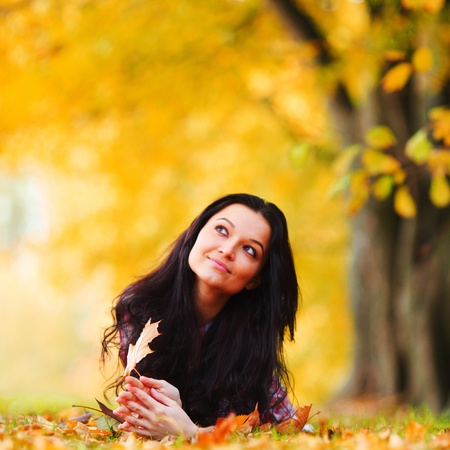 one people: woman on leafs in autumn park Stock Photo