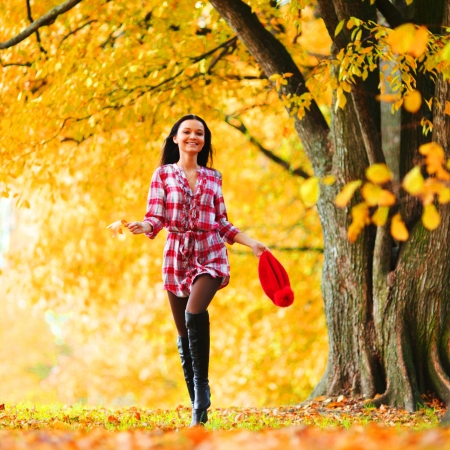fall fun: woman run in autumn park Stock Photo