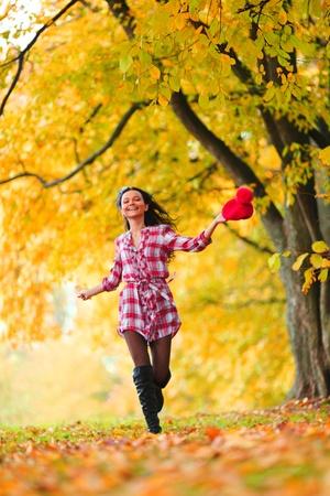 woman run in autumn park photo
