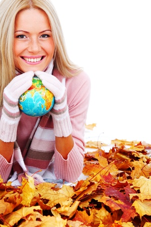 woman woman take globe in hands on autumn leaves Stock Photo - 10917301