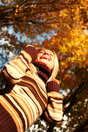 autumn woman on leafs in park Stock Photo - 10917477