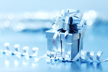 blue christmas gift on silver background Stock Photo