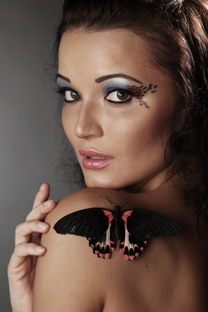 woman and butterfly on black Stock Photo - 10940185