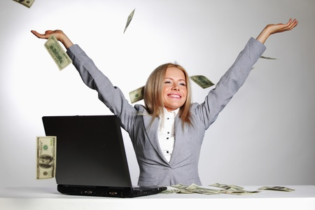 business woman drop dollars in the air  Stock Photo - 10940535