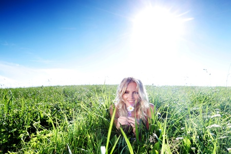 outsides: woman on green grass close up Stock Photo
