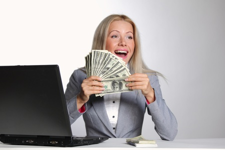 business woman working on laptop dollar in hands Stock Photo - 10940522