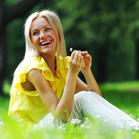 woman dachshund in her arms on grass Stock Photo - 10940513