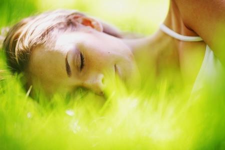 woman sleep on green grass photo