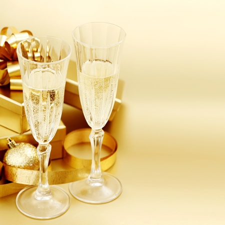 champagne bubbles: golden christmas background champagne gifts ball Stock Photo
