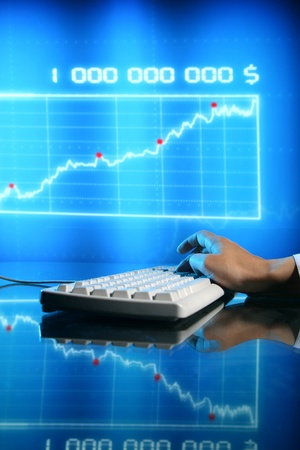 businessman input finance data information on keyboard photo
