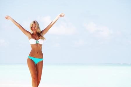 swimsuit model: woman in bikini on sea beach Stock Photo