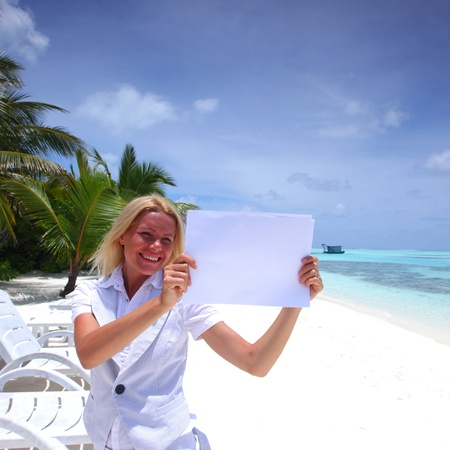 sexy teacher: business woman with blank paper on the desolate ocean coast Stock Photo