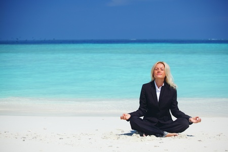beach yoga: yoga business woman in lotus pose on the beach Stock Photo