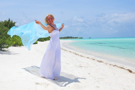woman with a white fabric in his hands on the beach Stock Photo - 11031194