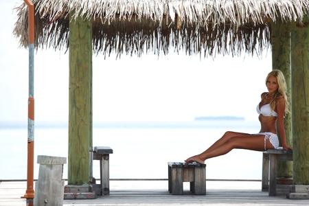 woman on the veranda of the tropical house photo