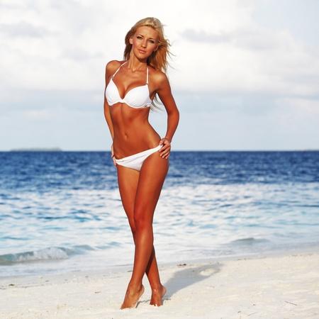 swimsuit model: woman on the ocean coast