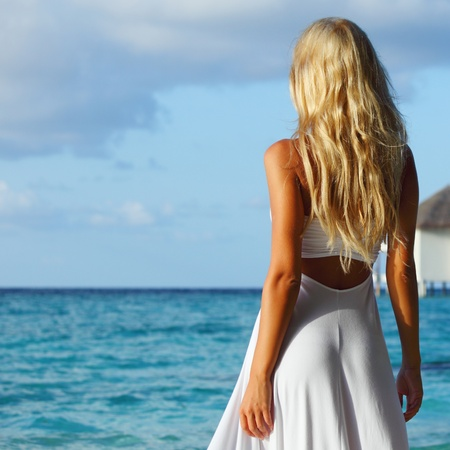 woman on tropical beach house back on the background Stock Photo - 11031199