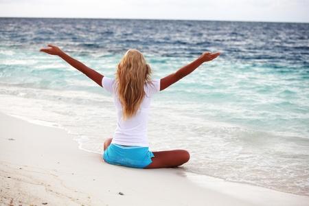 yoga woman on sea coast photo