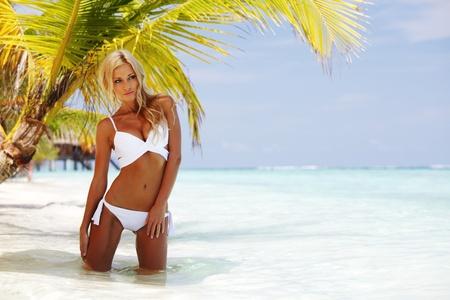 woman under palm sea on backgroud photo