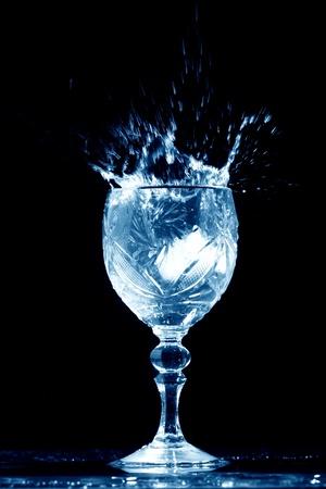 splash mixed: alcohol splash on black  background