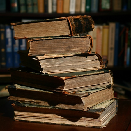 books on table in dark library room Stock Photo - 11072824
