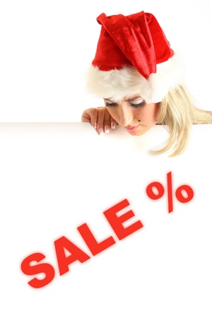 santa girl take in hands banner with sale sign  photo