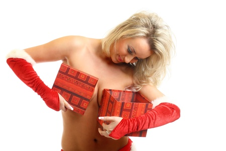 sexy santa girl hide behind gift box photo
