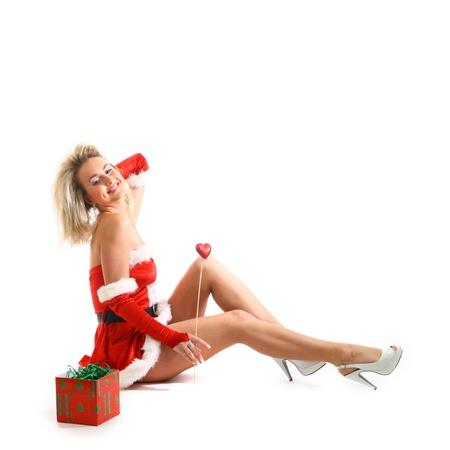 pin-up santa girl and christmas gift photo