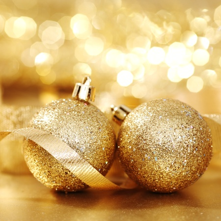 golden christmas ball on golden bokeh background photo