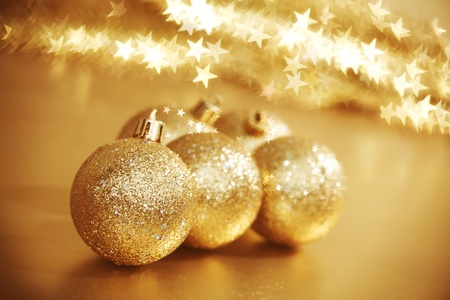 golden christmas ball on golden star bokeh background Stock Photo - 11084205