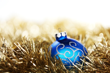 blue christmas ball on golden background photo